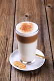 Latte macchiato. Glass of Latte macchiato with a dusting of nutmeg Royalty Free Stock Image