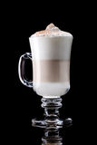 Latte macchiato. Cup of coffee latte macchiato on a black background Stock Photos