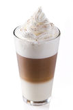 Latte macchiato. With whipped cream and cinnamon Royalty Free Stock Photos