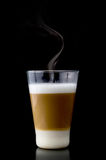 Latte macchiato. In front of black background Royalty Free Stock Photo