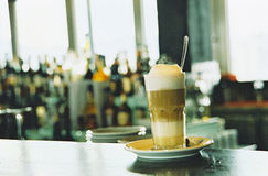 Latte macchiato. On counter in a cafe Stock Photos