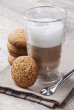 Latte macchiato cafee. Glass of Latte macchiato cafee with cookies Royalty Free Stock Photos