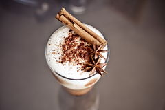 Latte macchiato with cinnamon Stock Images