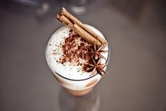 Latte macchiato with cinnamon Stock Images