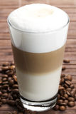 Latte macchiato with coffee beans Royalty Free Stock Photography