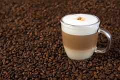 Latte macchiato. On coffee beans Stock Photography
