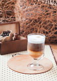 Latte macchiato. With coffee beans with coffee background, copy space Royalty Free Stock Image