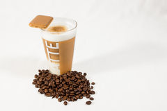 Latte macchiato 03. Latte macchiato with coffee beans and coockie stock photo