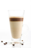 Latte macchiato with coffee beans isolated on white background Royalty Free Stock Photos