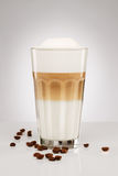 Latte macchiato with coffee beans Stock Images