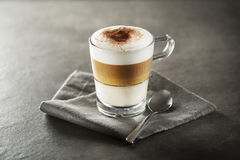 Latte macchiato coffee. Glass of hot Latte macchiato coffee close up Stock Photography