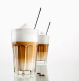 Latte macchiato. Coffee in a glass isolated on white Stock Photo