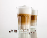 Latte macchiato. Coffee in a glass isolated on white Royalty Free Stock Photography