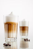 Latte macchiato. Coffee in a glass  on white Royalty Free Stock Image