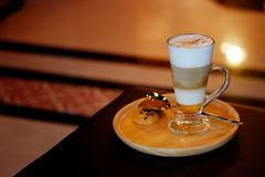 Latte macchiato coffee Served with cookie in brown earth tone color background. And have some space for write wording stock photo