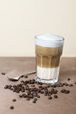 Latte macchiato with coffeebeans Royalty Free Stock Photos