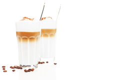 Latte macchiato in front of another latte macchiato Royalty Free Stock Photography
