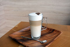 Latte Macchiato In Glass Cup. On The Wooden Table Stock Photo