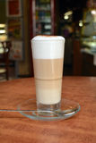 Latte Macchiato In Glass Cup On The Wooden Table Stock Images