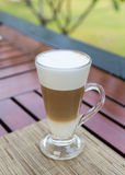 Latte macchiato in a glass with milk froth Stock Photo