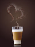 Latte macchiato with steam in heart shape Royalty Free Stock Photo