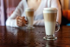Latte macchiato in tall glass close up royalty free stock photo