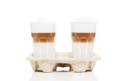 Latte macchiato to go. In cupholder on white background Royalty Free Stock Photography