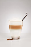 Latte macchiato with a vanilla bean Royalty Free Stock Photo