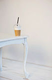 Latte macchiato on the white wooden table. Empty room. Place for text Royalty Free Stock Images