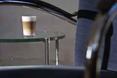 Latte Machiato. On a glass table Royalty Free Stock Photography