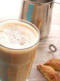 Latte Machiatto. Glass of coffee, Latte Machiatto on a table Stock Images