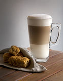 Latte and rusks. Latte with rusks on a wooden surface Stock Image