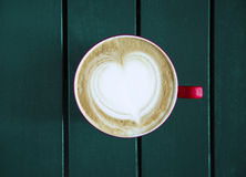 Latte served with cup on the table royalty free stock photos