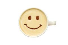 Latte sztuka - odosobniona filiżanka kawy z uśmiechem Obrazy Stock