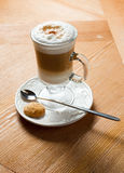 Latte on a wooden table Royalty Free Stock Photography
