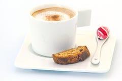 Latte y Biscotti Imágenes de archivo libres de regalías