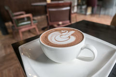 Lattekonst i kafét Fotografering för Bildbyråer