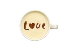 Lattekunst - lokalisierter Tasse Kaffee mit 'Liebes' Zeichnung Lizenzfreies Stockfoto
