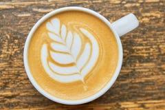 Lattekunstblume Stockfoto