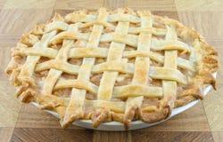 Lattice Apple Pie. Baked apple lattice pie on a wooden table Royalty Free Stock Photography