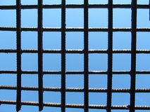 Lattice. Blue sky through the bars Stock Photo