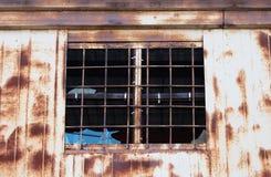 Lattice and broken windowpane. Window with lattice and the broken windowpane in old barrack Royalty Free Stock Photography