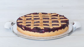 Lattice cake with forest berries on wooden board Stock Photos