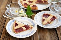 Lattice cake with strawberry jam cut, piece of cake, jasmine flo Stock Photos