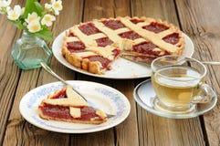 Lattice cake with strawberry jam cut, piece of cake, jasmine flo Royalty Free Stock Image