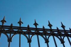 Lattice cast iron fence against the blue sky Royalty Free Stock Photos
