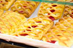 Lattice Danishes. Lattice patterned danishes cooling in a bakery royalty free stock photo