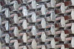 Lattice dilapidated balconies of the standard rooms of the old unfinished hotel as background or backdrop royalty free stock images
