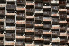 Lattice dilapidated balconies of the standard rooms of the old unfinished hotel.  Stock Image