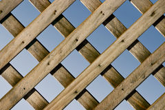 Lattice Fence. A Closeup of a Wooden Lattice Fence with Blue Sky stock image